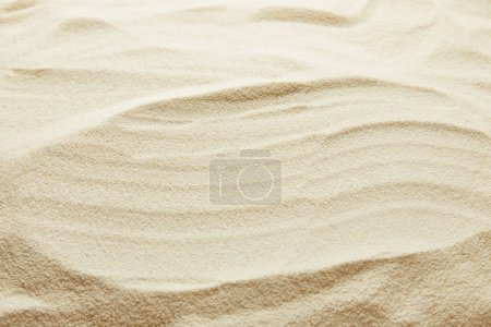 textured wavy golden sand background with copy space