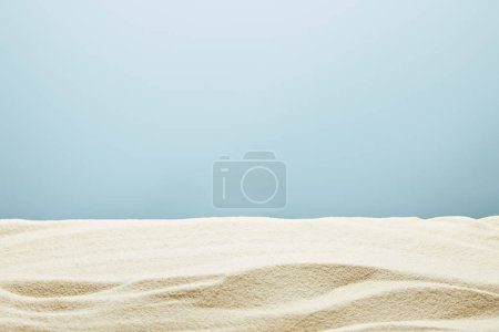 Photo for Wavy textured golden sand on blue background - Royalty Free Image