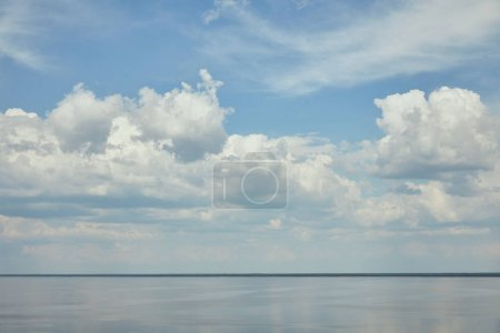 Landscape with light blue sky and river