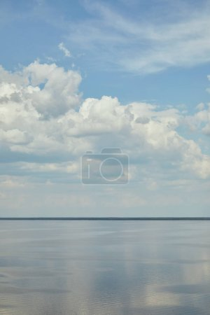 Photo for Peaceful landscape with river and white clouds on blue sky - Royalty Free Image