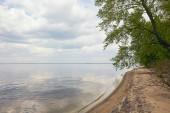 "Постер, картина, фотообои ""Peaceful landscape of blue sky and river with tree on sand beach"""