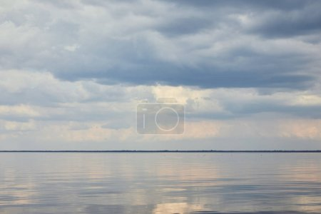 Photo for River over blue and peaceful sky with white clouds - Royalty Free Image