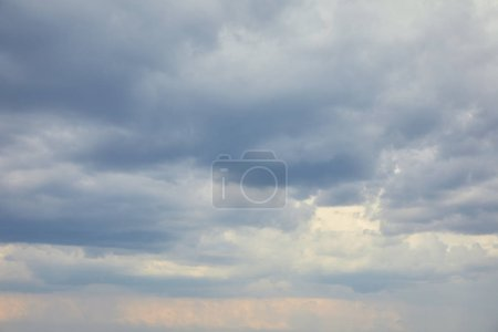 White clouds on peaceful blue sky with copy space