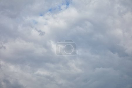 Dark sky with white clouds and copy space