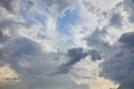 Photo for Blue clouds on blue sky background and sun rays - Royalty Free Image