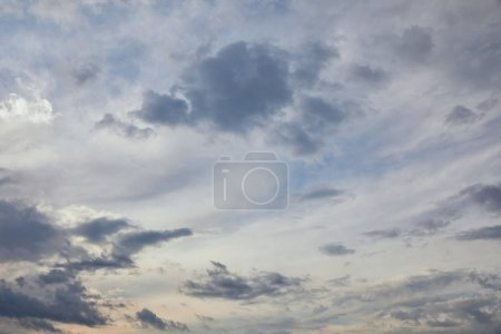 blue clouds on blue sky background and sun rays