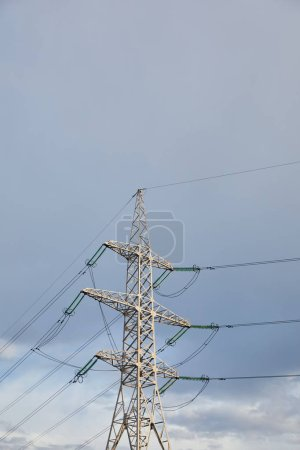 Photo for Low angle view of electric pole with wires on grey cloudy background - Royalty Free Image