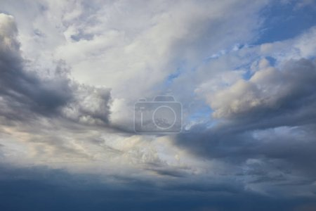 view of peaceful grey sky background with white and dark clouds