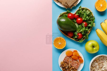 Photo for Top view of diet food on blue and pink background with copy space - Royalty Free Image