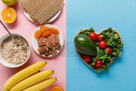 Photo for Top view of fresh diet food on blue and pink background with copy space - Royalty Free Image