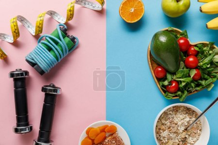 Photo for Top view of delicious diet food and sport equipment with measuring tape on blue and pink background - Royalty Free Image