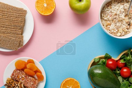 Photo for Top view of delicious diet food and sport equipment on blue and pink background with copy space - Royalty Free Image