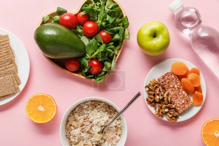 Photo for Top view of fresh diet food and water on pink background - Royalty Free Image