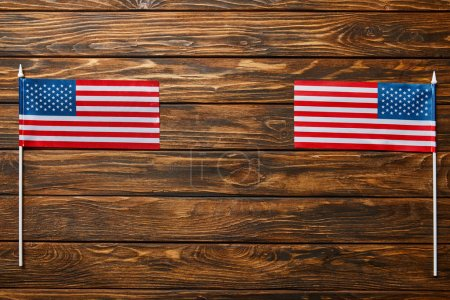 top view of national american flags on wooden surface with copy space