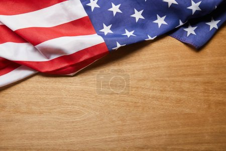 Photo for Top view of american flag on beige textured wooden surface with copy space - Royalty Free Image