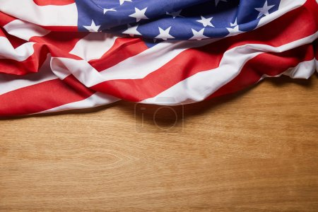 Photo pour Top view of american flag on beige wooden table with copy space - image libre de droit