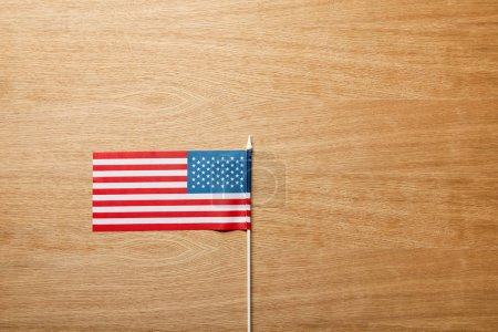 top view of american flag on wooden table with copy space