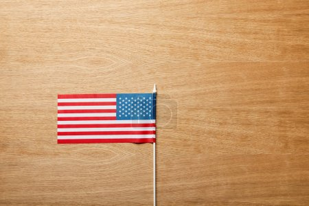 Photo for Top view of american flag on wooden table with copy space - Royalty Free Image