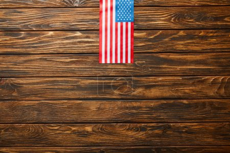 Photo for Top view of american flag on wooden weathered background - Royalty Free Image