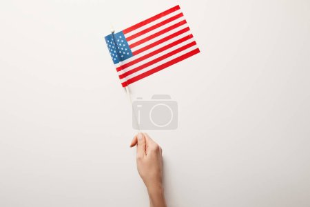Photo for Top view of woman holding american flag on white background - Royalty Free Image