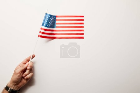 top view of man holding american flag on white background