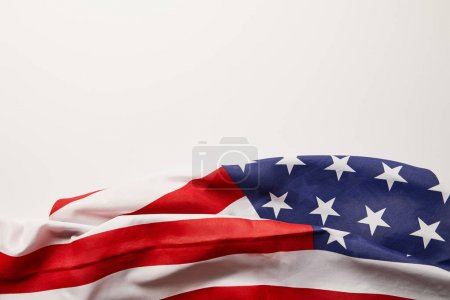 Photo for Top view of crumpled american flag on white surface with copy space - Royalty Free Image