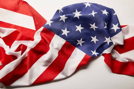 Photo pour Top view of crumpled national american flag on white background - image libre de droit