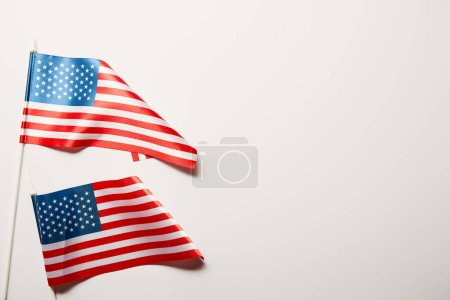 Photo for Top view of bright american flags on white background with copy space - Royalty Free Image