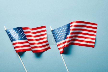 top view of american flags on blue background