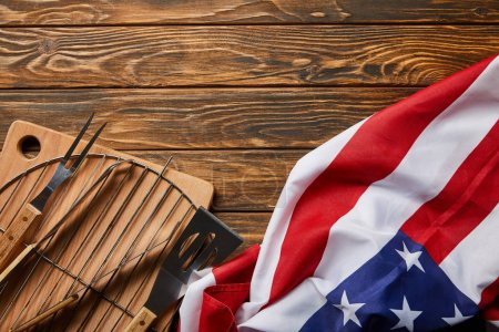 Photo for Top view of american flag near bbq equipment on wooden rustic table - Royalty Free Image