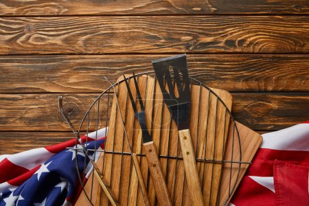 Photo for Top view of american flag and bbq equipment on wooden rustic table - Royalty Free Image