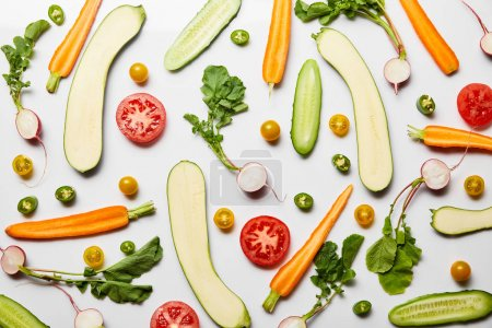 Photo for Top view of fresh sliced vegetables on white background - Royalty Free Image