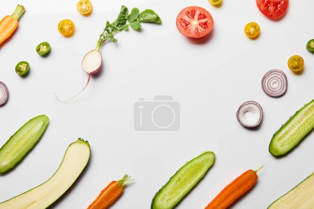 Photo for Top view of fresh sliced vegetables on white background with copy space - Royalty Free Image