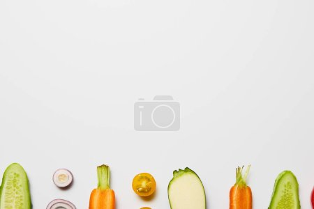 Photo for Top view of fresh cut vegetables on white background with copy space - Royalty Free Image