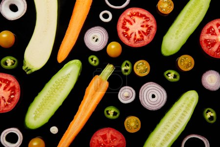 Photo for Top view of fresh ripe sliced vegetables isolated on black - Royalty Free Image