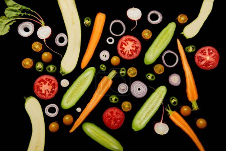 top view of tasty vegetable pattern isolated on black
