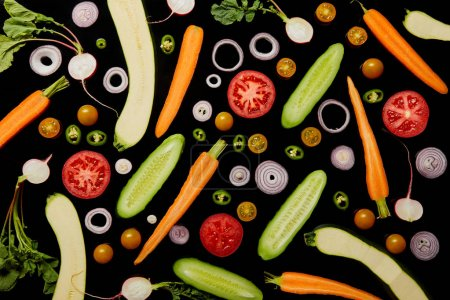 Photo for Top view of delicious vegetable pattern background isolated on black - Royalty Free Image