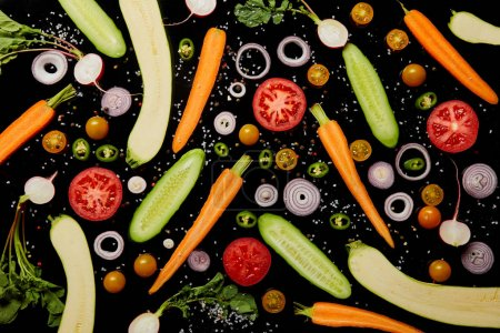Photo for Top view of fresh vegetable slices with salt isolated on black, background pattern - Royalty Free Image