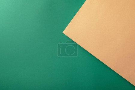 Foto de Creative background with green and beige paper - Imagen libre de derechos