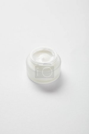 Photo for Open glass jar with face cream on white - Royalty Free Image