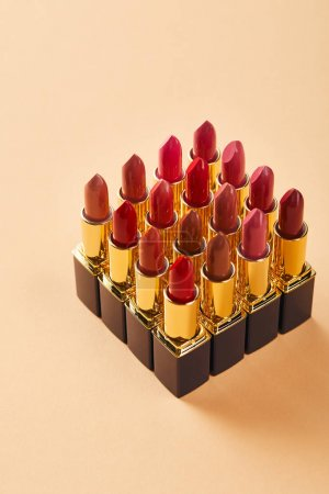 Photo for Close up of various lipsticks on beige - Royalty Free Image