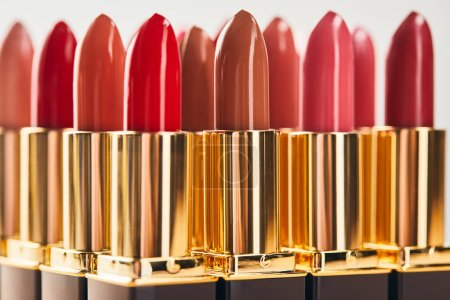 Photo for Various red shades of lipsticks isolated on grey - Royalty Free Image