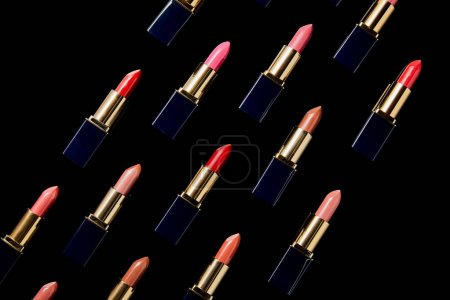 Photo for Flat lay with various shades of lipsticks isolated on black - Royalty Free Image