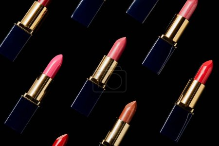 Photo for Background with various shades of lipsticks isolated on black - Royalty Free Image
