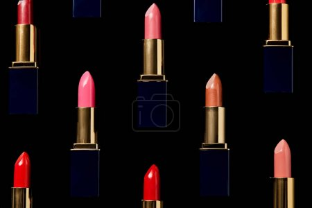 Photo for Background with different shades of lipsticks isolated on black - Royalty Free Image