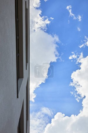 Photo for Bottom view of building and blue sky with clouds - Royalty Free Image