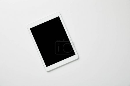 Photo for Top view of digital tablet on white surface - Royalty Free Image