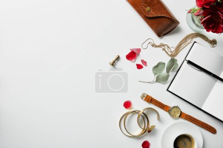 Photo for Top view of notepad, pen, case, plants and coffee on white surface - Royalty Free Image