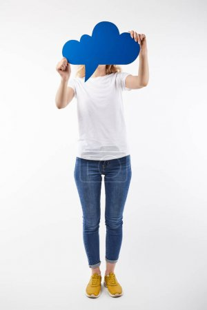 Foto de Woman with blue thought bubble in hands standing isolated on white - Imagen libre de derechos