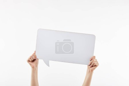 cropped view of woman with speech bubble in hands isolated on white